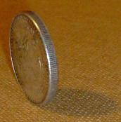 A Coin Balanced on Its Edge